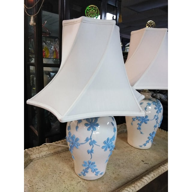 For your consideration is this pair of Mid Century Japanese Table lamps. The Off white ceramic is decorated with a modern...