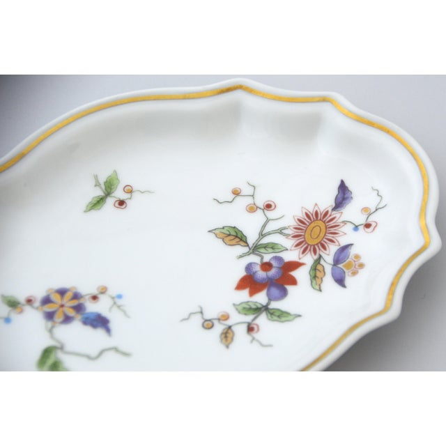Beautiful Italian Oriente Collection by Richard Ginori. The edge is scalloped and trimmed with gold. Floral decor with...