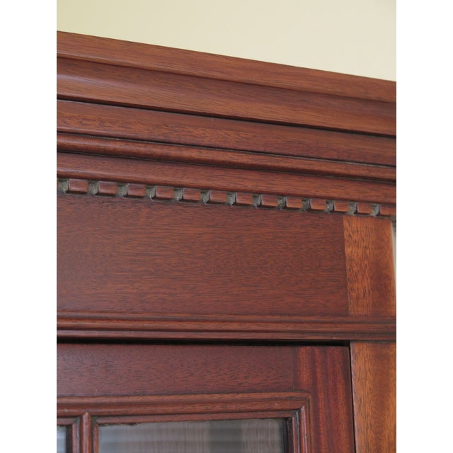 Craftique chippendale solid mahogany corner cabinet. Features solid mahogany, high quality construction, dentil crown...