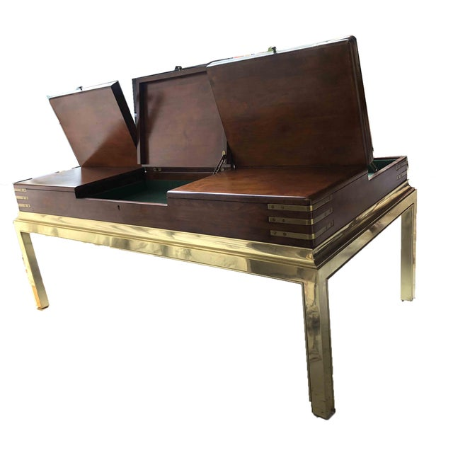 We have a vintage Stanley Furniture coffee table in excellent condition. Brass legs and frame with walnut veneer surface...