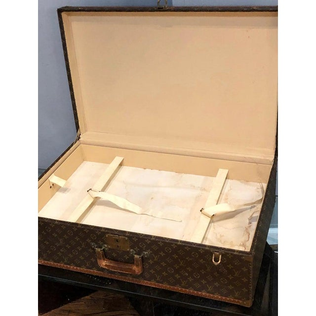 Louis Vuitton suitcase travel case in the iconic monogram canvas bearing the initial P-under the leather handle. In...