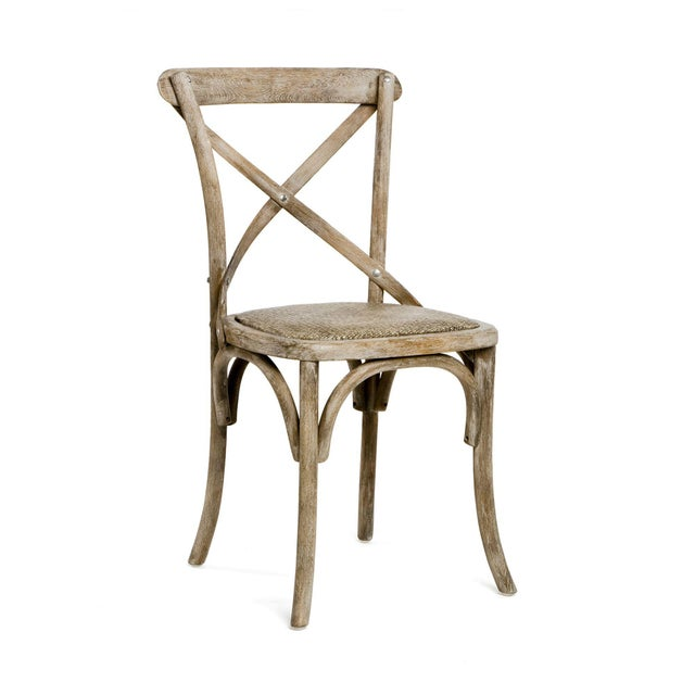 Cross-back stool with rattan seat in limed grey finish.
