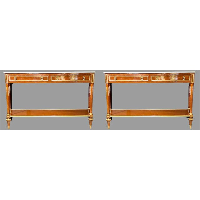 A fine pair of Louis XVI style marble top consoles or sideboards in the Maison Jansen Manner. These simply stunning...