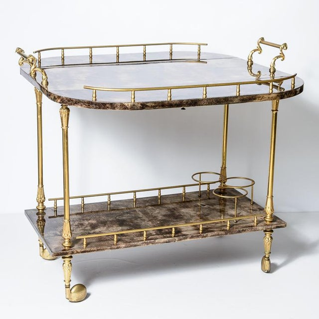 Great find! A chocolate color lacquered goatskin BarCart by the well Know renown Designer, Aldo Tura.. This bar cart has...