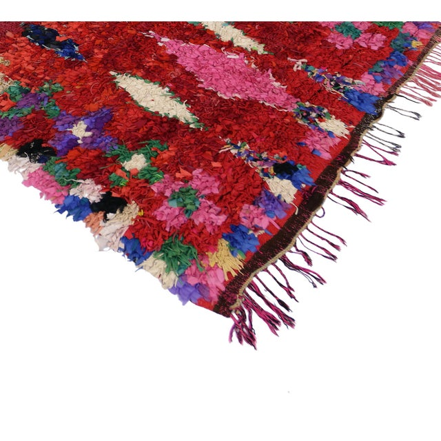 This Vintage Berber Moroccan Boucherouite rug marries the vintage style of the Berbers with a vivacious color scheme...
