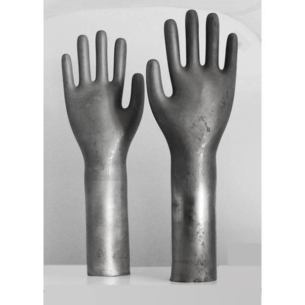 Vintage industrial glove mold. Industrial gray color with nice metal patina. These literally were used as molds to make...