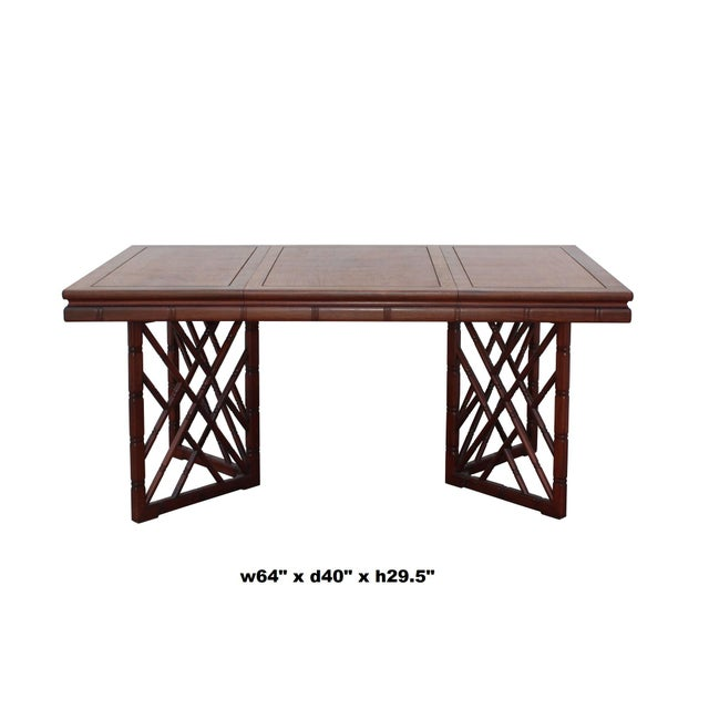 This is an oriental Chinese modified style rectangular table with bamboo simulated pattern base. There is simple delicate...