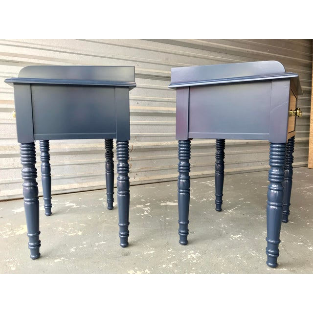 A pair of handsome high gloss navy blue end tables recently restored with new paint and new brass pulls. These are...