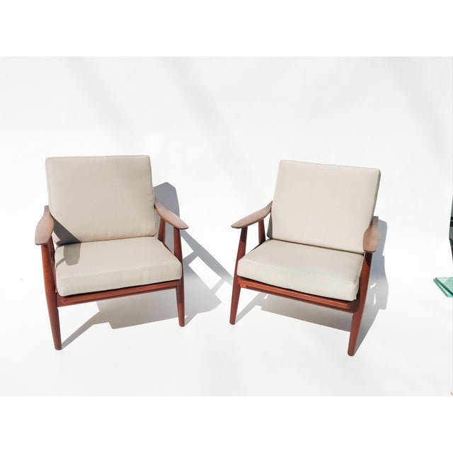 Never separated pair of Easy chairs in solid teak by Hans Wegner for Getama, Denmark 1950's. Original finish on frames,...
