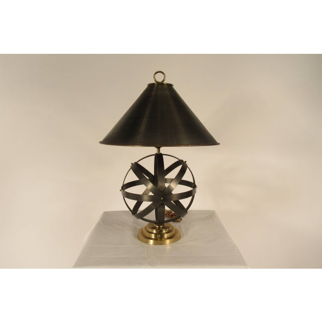 1970s metal orb lamp with metal and brass shade.