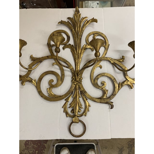 Scrolled Gilt Metal Candle Wall Sconce with 4 arms. Center leaf design, ring on bottom. Perfect for your dining room. Very...