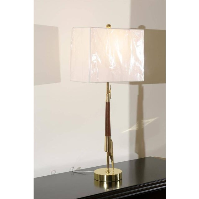 An exquisite pair of lamps from a difficult to find series by Rembrandt, circa 1960. A tall, elegant modern design...