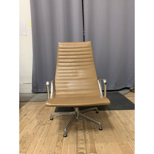 Design Plus Gallery presents a Mid-20th Century Eames Aluminum Group Lounge Chair. Warm cognac leather has an inviting +...