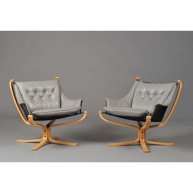 "A pair of ""Falcon"" armchairs by Sigurd Ressell for Vatne Mobler, Norway. Clear birch frame, stretched with canvas, button..."