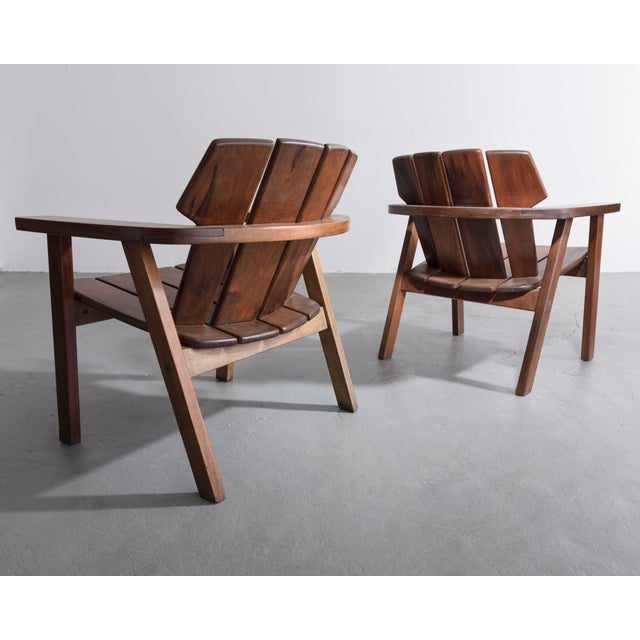 Sergio Rodrigues Pair of slatted rosewood lounge chairs by Sergio Rodrigues, Brazil, 1960s. For Sale - Image 4 of 8