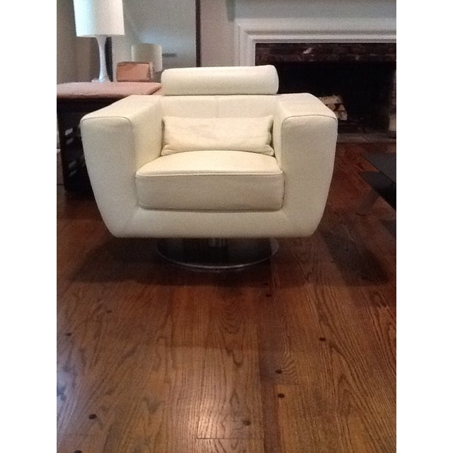 Set of white Italian leather swivel chairs are the perfect balance of sophistication and modern elegance. Each has a...