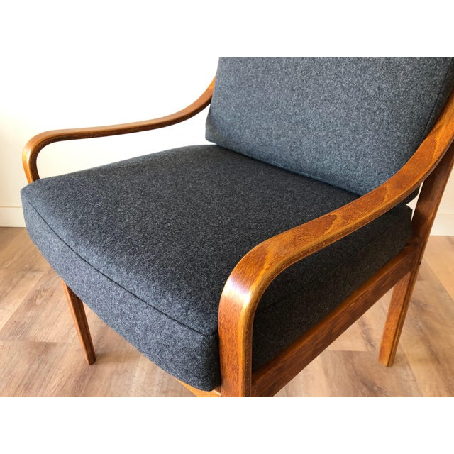 Newly-upholstered in Pendelton wood fabric. Restored. New cushions and restored frame. Made in Denmark. The seat back has...