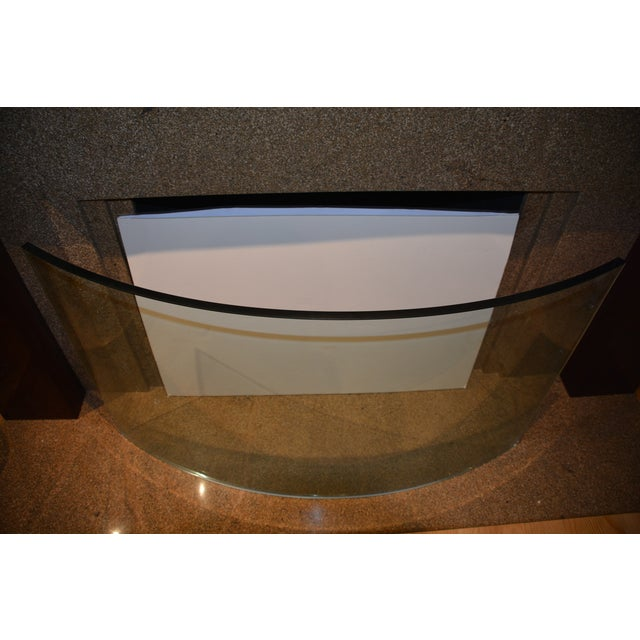 "An incredible piece of functional art made of 3/4"" thick plate glass Custom 3/4"" thick plate glass fireplace screen...."