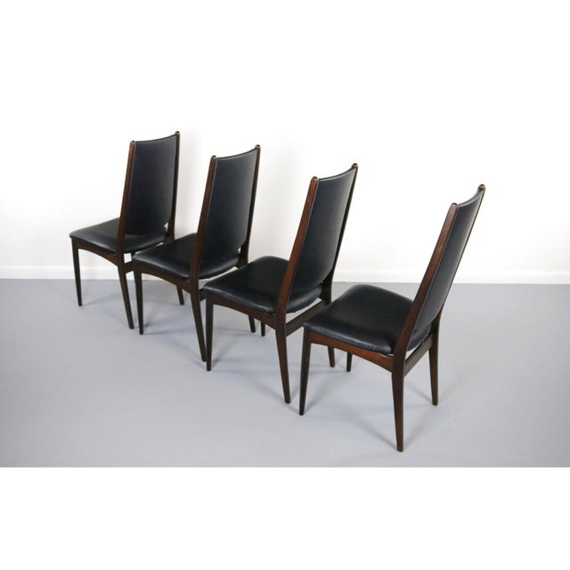 About the Rosewood Danish Modern Dining Chairs - A Set of 4 This set of 4 Danish Modern Dining Chairs in brilliant...