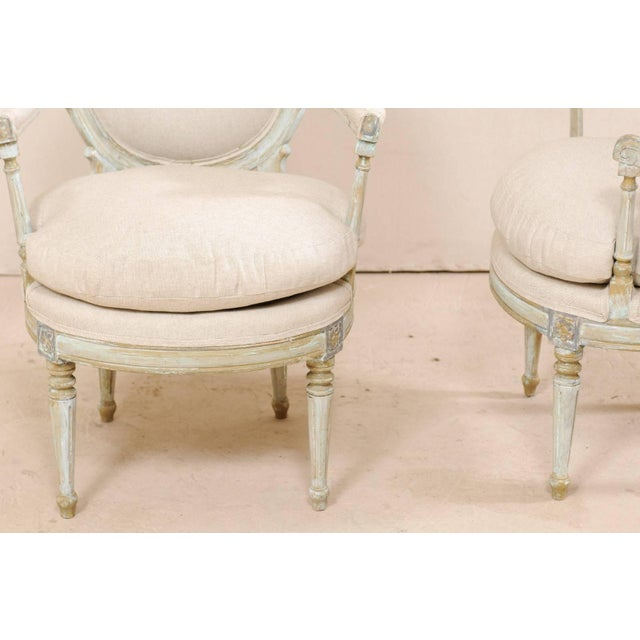 White Pair of French Oval-Back Bergère Chairs With Delicately Carved Floral Motifs For Sale - Image 8 of 11