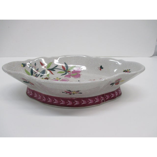 Chinese Export Vintage Decorative Dish With a floral motif in shades of pink, green, red, blue orange, violet and grays....