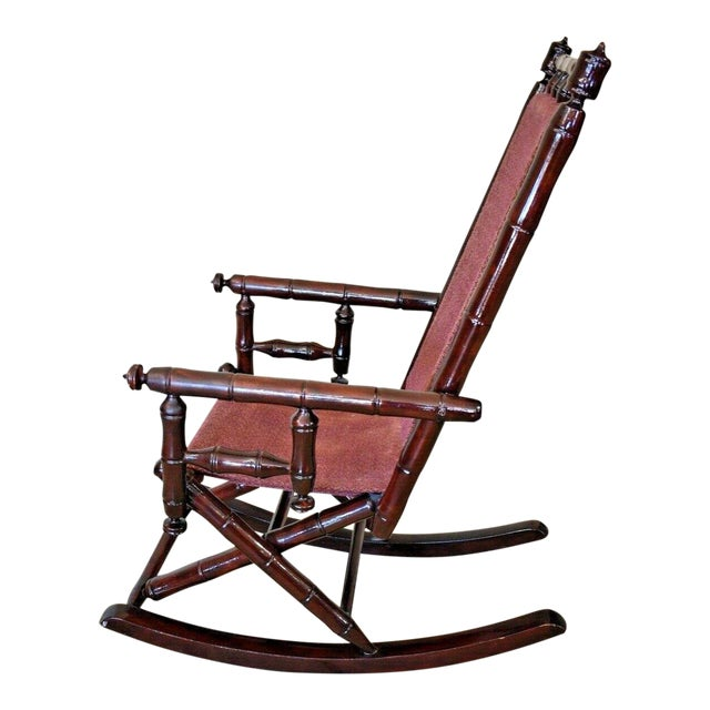 Vintage Faux Bamboo Rocking Chair With Mahogany Finish and Maroon Upholstery For Sale