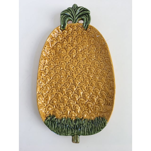 Offering a lovely dimensional platter in the shape of a large pineapple. This golden pineapple is hand painted and made by...