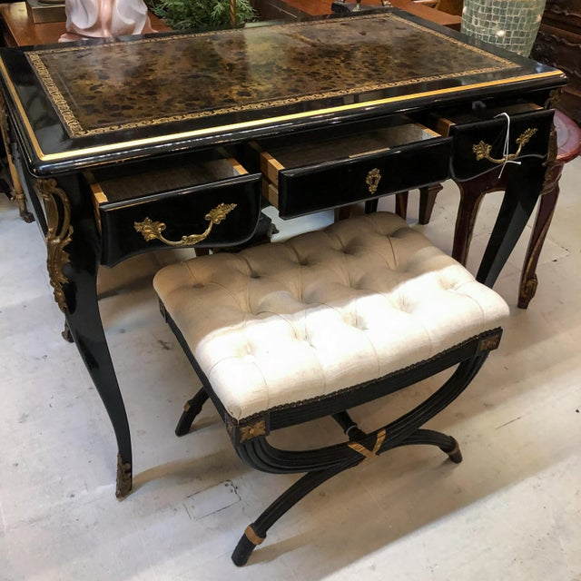 Black lacquer Louis XV style desk / secretary with brass details and leather top. Neoclassical stool in black lacquer with...