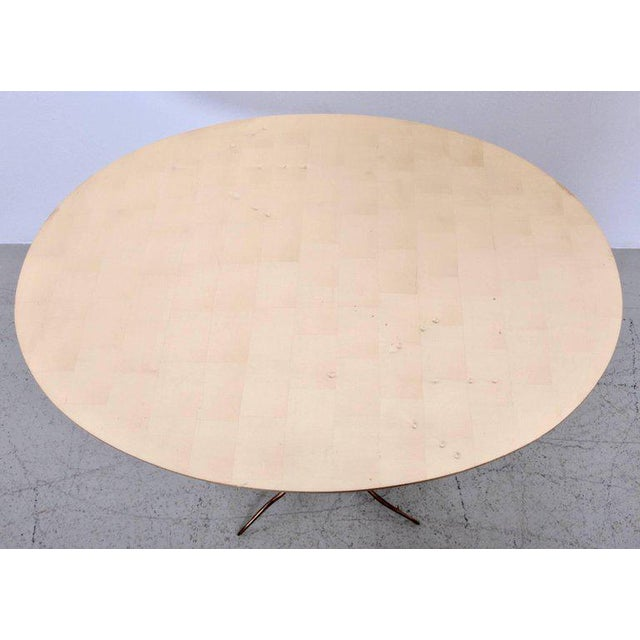 Very early Traccia coffee table in bronze, gold leaf and wood by Meret Oppenheim (Italy, 1970s). The oval shaped tabletop...
