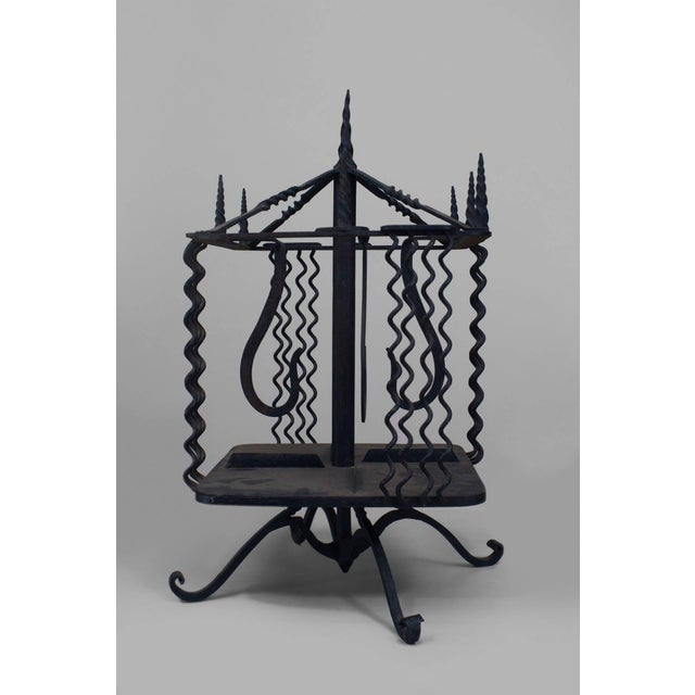 Turn of the Century Italian Renaissance style wrought iron revolving table top book stand with finials on top and wavy...