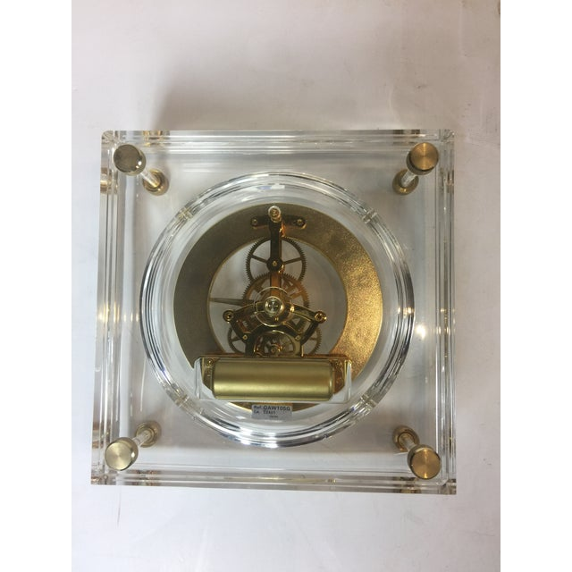Magnificent and beautiful mid century modern Lucite Japanese table clock seiko. Great chick and sleek square shape clear...