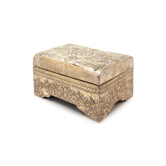 A Silver-Clad Table Casket 20th Century the domed hinge top centered with a paterae among foliate scrolls.