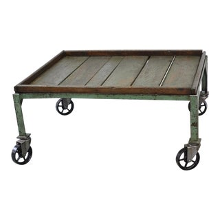 Industrial Rustic Iron and Wood Coffee Table With Iron Casters For Sale