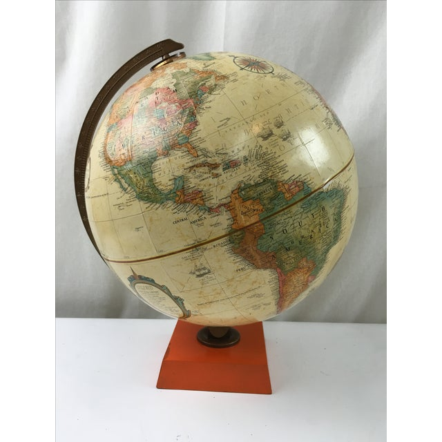 "Vintage Replogee 12"" World Classic Series terrestrial globe with bright orange painted base. Dents and minimal damages due..."
