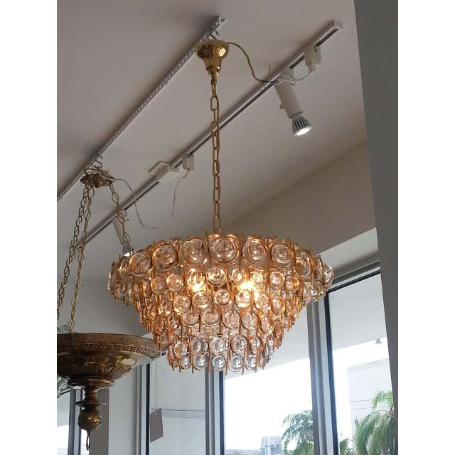 """This beautiful chandelier was produced in the 1970s by Palwa of Germany, a firm known for its """"Jewel Crystals"""". The piece..."""