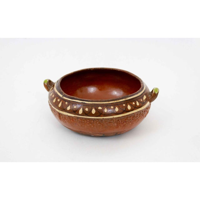 Mid-century Mexican pottery for the tourist trade. A beautiful hand painted vintage piece with typical vintage character.