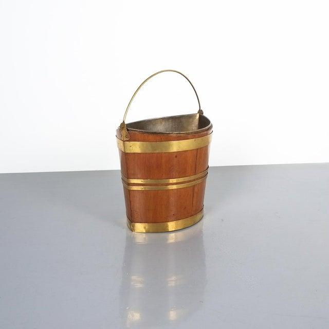 Irish 19th Century Oval Oak Brass Peat Bucket. Beautiful bucket that would make for an interesting waste paper bin or wine...