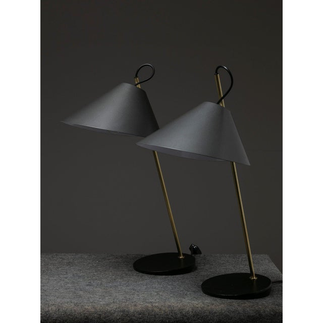 Set of two Base Ghisa table lamps by Luigi Caccia Dominioni for Azucena. Cast iron base supporting a thin brass stem with...