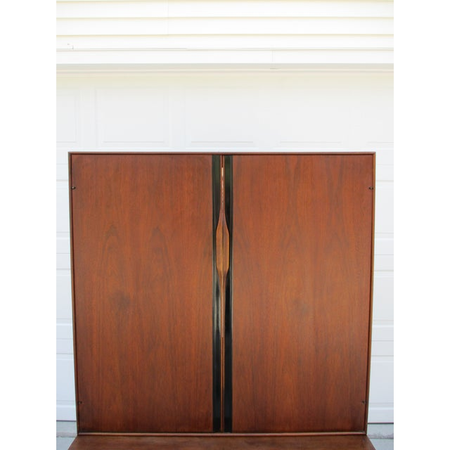 Iconic John Kapel for Glenn of California walnut armoire. This two-piece armoire features a large lower section which...