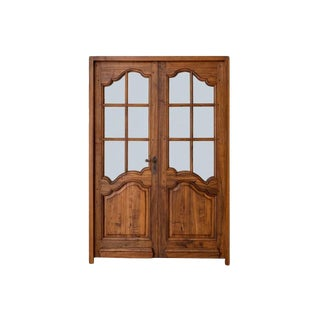 Pair of French Louis XV Style Walnut Entry Doors For Sale