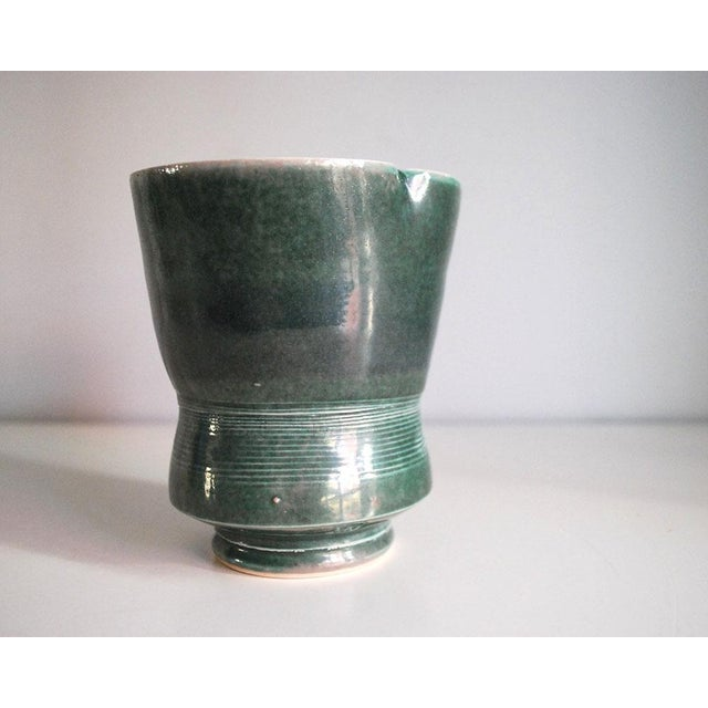 Lovely vintage studio art pottery vase or planter, dating from the mid to late 20th century, is made of porcelain and...