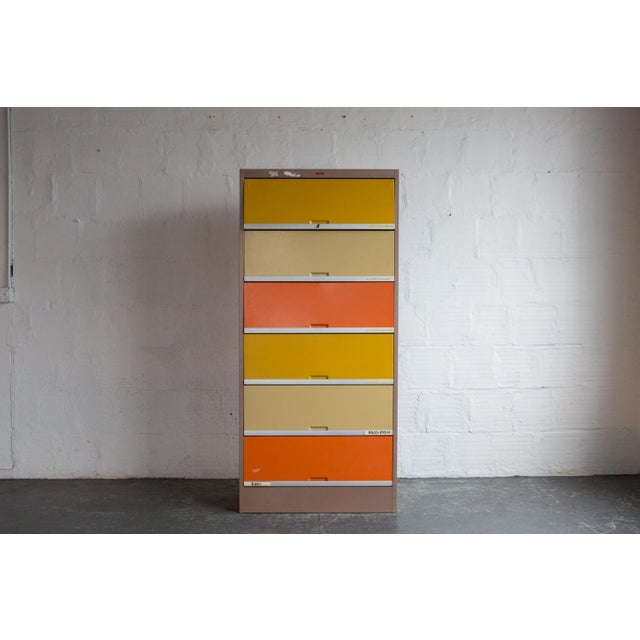 Vintage orange and yellow steel office cabinets. These color-filled file cabinets are sure to brighten your space! With...