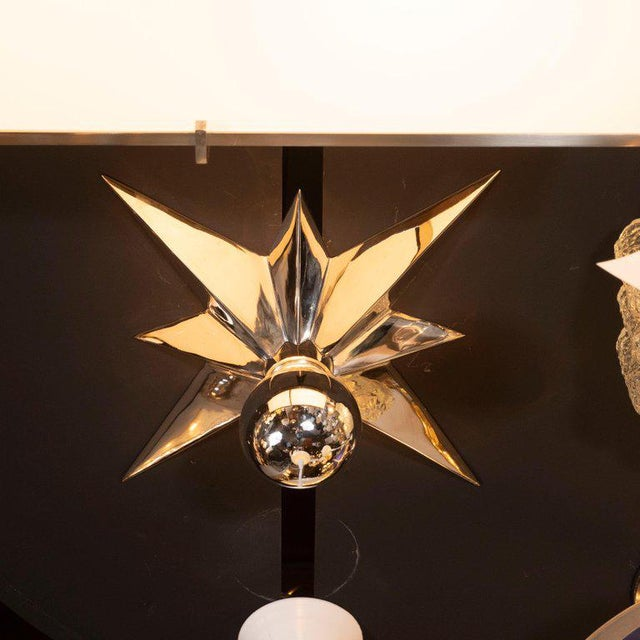 This graphic and refined set of four flush mounts were realized in the United States, circa 1980. Each flush mount...