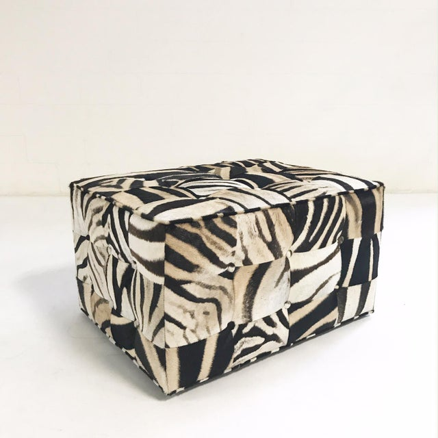 Our master upholsterers created this brand new, beautiful ottoman for us. Each square of zebra hide is hand selected and...