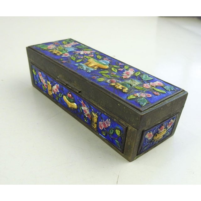 Vintage brass stamp box with enamel decoration. Marked China on bottom and sloped interior bottom. Overall patina with a...