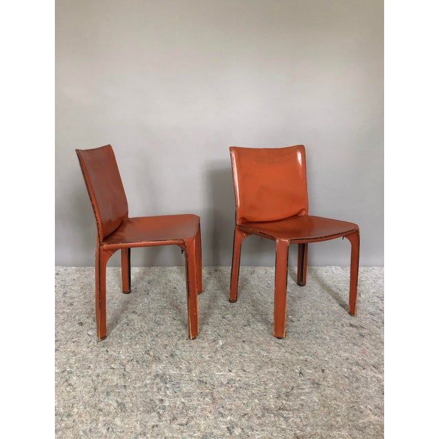Offering a set of two beautiful Cassina CAB dining chairs in an oxblood red stitched saddle leather. Designed by Mario...