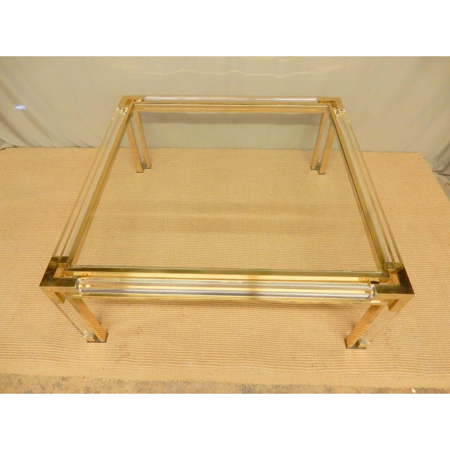 Exceptional Italian brass, lucite and glass mid-century coffee table.