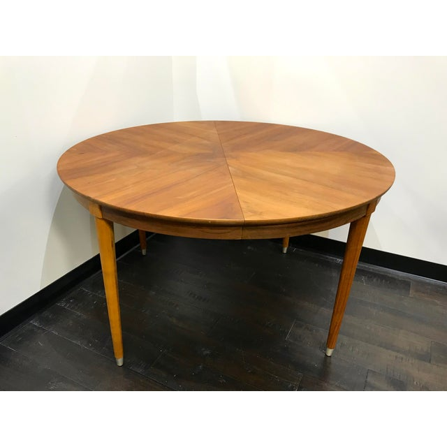 Look at that wood grain! This gorgeous solid wood dining table by BP John has been refinished with a walnut stain to...
