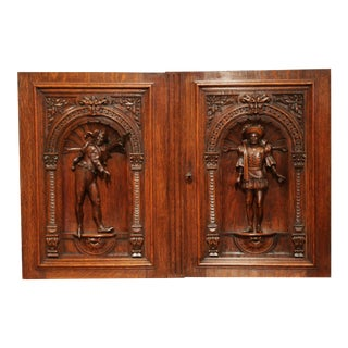 Pair of 19th Century French Henri II Carved Oak Doors With High Relief Carvings For Sale