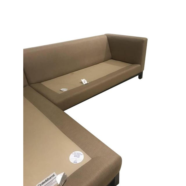 Stunning sectional sofa by Crate & Barrel perfectly designed sofa that has remained in a single collection since it was...